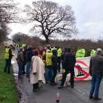 Local People Massing On Road Outside Upton Camp AS Police Block Road