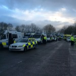Large Numbers Of Police Vehicles Parked Near Upton Camp