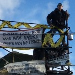Person Occupying A Scaffold Tower Resists Eviction Attampt At Upton Camp