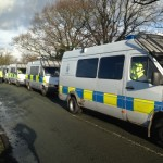 Long Line Of Police Vans Outside Upton Camp
